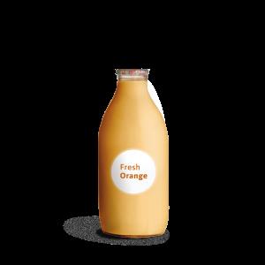 glass bottle of orange juice