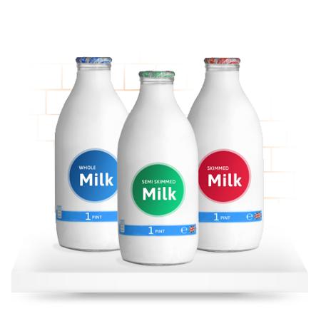 glass milk bottles on shelf